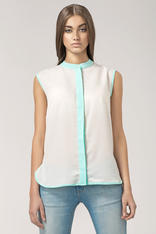 Off white sleeveless blouse with contrast green piping